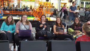 Tired students in Heathrow.