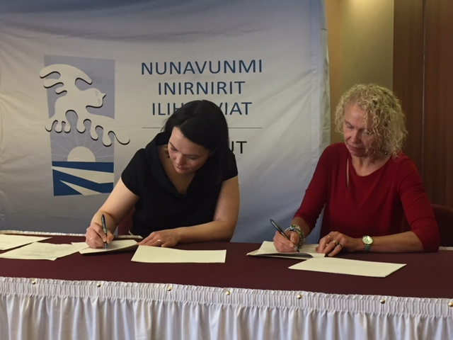 Dr. Vivian Howard signing of the MOU with Virginia Mearns