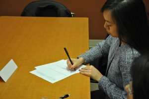 Karah Lee drafts her team's contract.