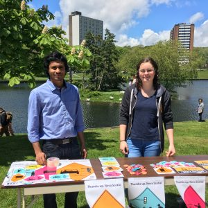 MD Jahedul Alam and Sara Campbell promoting the Share the Road Nova Scotia campaign at Switch Dartmouth.