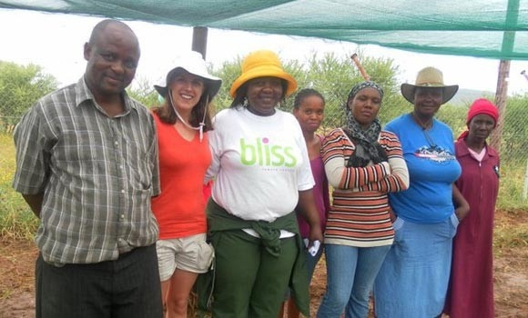 Alison Ahern (second from left) poses with volunteers at the community garden in Mokolodi, Botswana