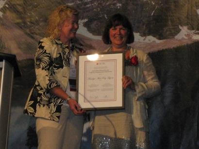 Dr. Marilyn MacKay-Lyons receiving the Enid Graham Memorial Lectureship