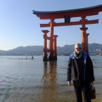 Dr. Carswell visiting the Itsukushima Shrine's Torii Gate in Miyajima