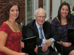 John Eldon Green presents scholarships to Danya O'Malley (left) and Alicia Rose