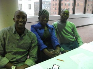 Dr. Christian Mukwesi and Dr. Theoneste Mwumvaneza sit with Abena Amoako-Tuffour, coordinator of the Global Health Office of Anesthesia