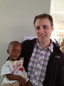 Dr. Calder with a child whose cleft lip he repaired. They are in the postop room - literally one room with about 30 mattresses on the floor!