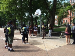 Tupper Courtyard: Camp Counsellor Korede leads some ice breakers