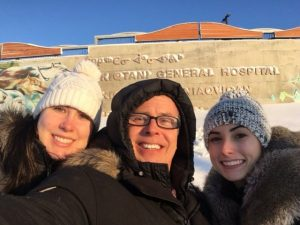 Shannon (left), Dr. Clay Marco and Laura (right) in front of the Qikiqtani General Hospital in the Baffin Region in Nunavut
