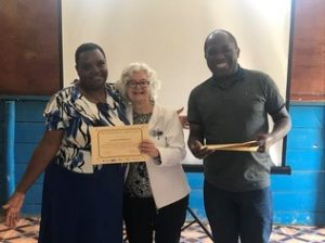 Ugandan colleague receiving certificate