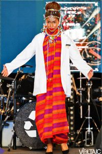 Competing in Canada's Next top pharmacist representing Dalhousie University showcasing my traditional Kenyan outfit with my white coat on during the white coat strut walk.