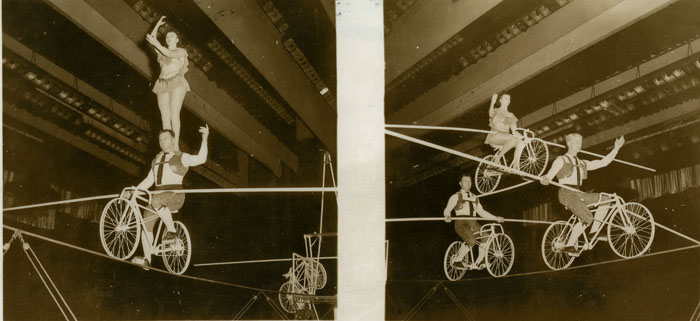 Bicycle high wire act at a Bill Lynch Show.  Photograph from an album in the Bill Lynch fonds (MS-4-218)