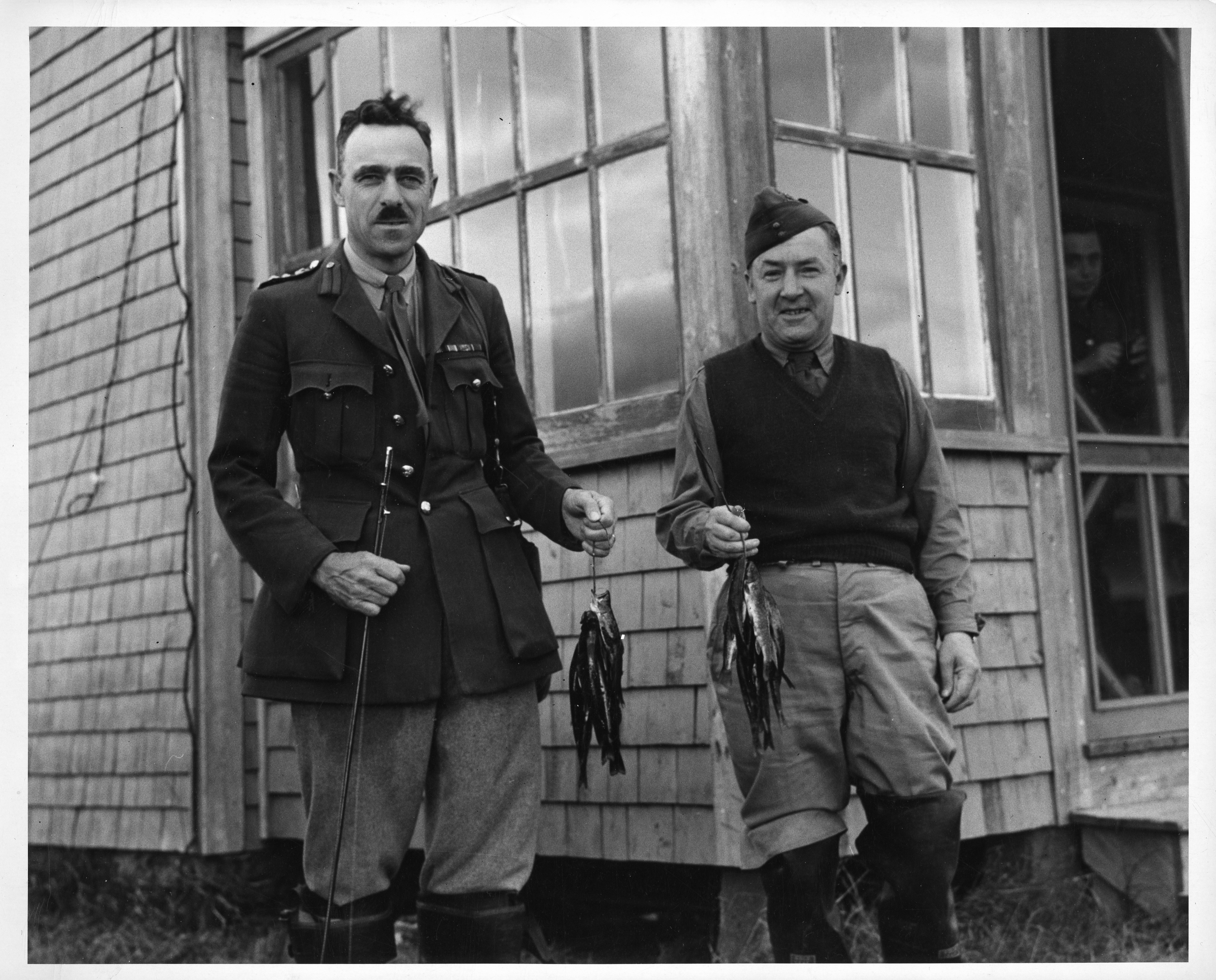 Brigadier Roome and Major Keen fishing at the Canadian Army artillery camp at Tracadie, New Brunswick [Canadian Army Photo].  Richard Edward Graham Roome fonds (MS-2-252) Box 2, File 9