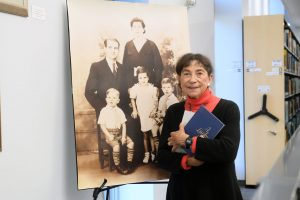 Dr. Boniuk with a photo of her family at the kellogg Library's 50th anniversary celebration. (Photo by Danny Abriel)