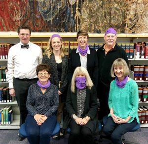 The Law-Di-Das model the snazzy purple bandanas they won. (from l-r): First row: Lisa Drew, Anne-Marie White, Anne Matthewman. Back row: David Michael, Hannah Steeves, Karen Tarum, Stephen Murray