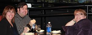 (l-r) Susan Hagen, Andre Richard and Darlene Hazel at a staff Christmas party.